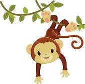 Cute cartoon monkey hanging on a liana.