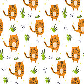 Cute cartoon pattern with tigers and grass