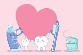 cute cartoon tooth hold heart