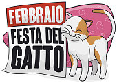 Lovely and cute kitty promoting Cat Day (written in Italian), rubbing in a reminder calendar to celebrate this special day in February.