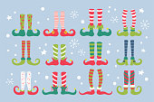 Cute Christmas elf feet with socks and shoes set. Childish print for cards, stickers and party invitations. Vector Illustration