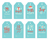 Set of cute winter holiday gift tags with hand drawn fonts and Christmas decoration.  Fully editable vectors.