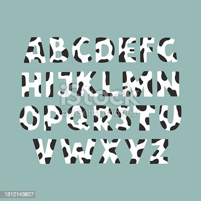 istock Cute cow skin alphabet for your design 1312143827