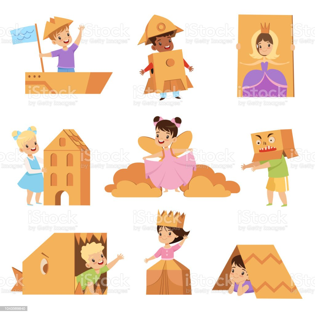 Cute Creative Kids Playing Toys And Costumes Made Of Cardboard Boxes
