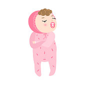 Cute baby with the pacifier and kinky hair in pink pajama standing displeased. Baby emotions concept. Isolated vector icon illustration on white background in cartoon style.