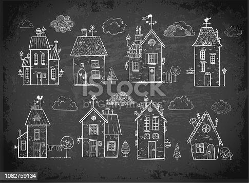 Cute doodle houses on blackboard background