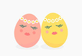 istock Cute Easter egg girls with spring flower crown. 1310427407
