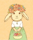 Cute easter rabbit girl in floral wreath