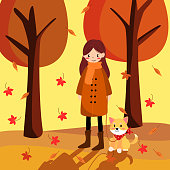Cute girl and lovely dog walking in morning of autumn. People in autumn seson concept.