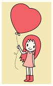 Cute girl holding love heart balloon