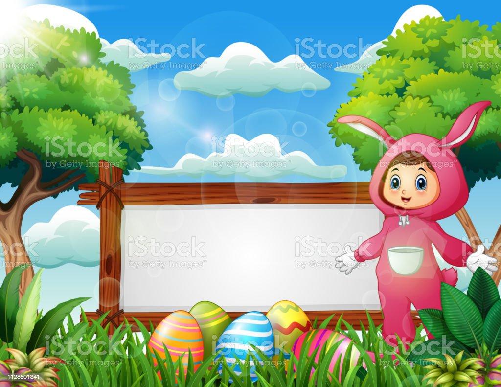 24abc140e Linda garota com uma fantasia de coelho rosa em pé perto de sinal em branco  e