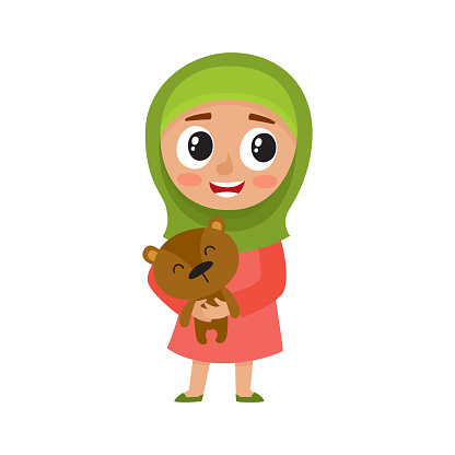 Cute girl in green hijab hold bear isolated on white.
