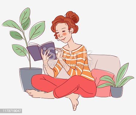 Cute girl reading a book