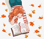 Cute girl reads a book stock stock