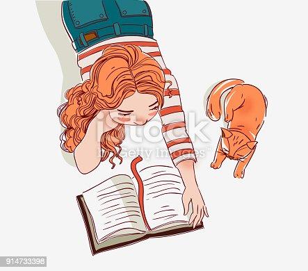 Cute girl reads a book