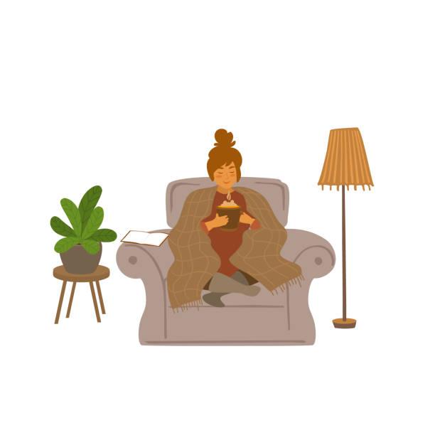niedliche mädchen sitzen auf einer couch mit heißgetränk zu hause cartoon-vektor-illustration-szene - cozy stock-grafiken, -clipart, -cartoons und -symbole