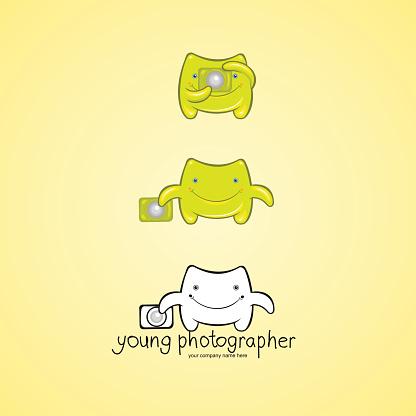 Cute green monster photographer character.
