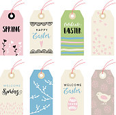 Cute hand drawn easter set of gift tags and labels with egg, chicken and flowers. Isolated vector objects.