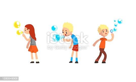 istock Cute Kids Blowing Soap Bubbles Through Wand Set Cartoon Vector Illustration 1330549300