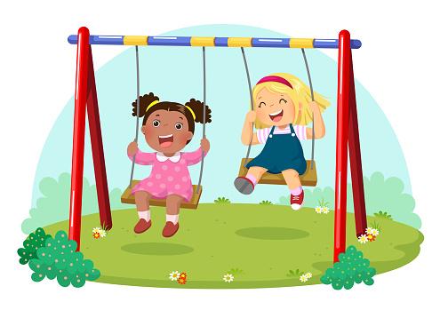Cute kids having fun on swing in playground