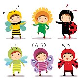 Cute kids wearing insect and flower costumes