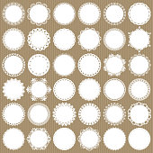 Cute lacy doilies mega set on cardboard background. For scrapbook, birthday or baby shower design.