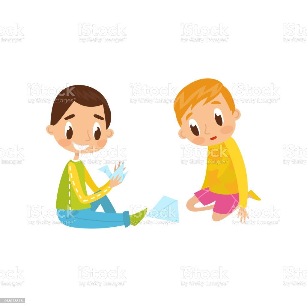 かわいい男の子と女の子の折り紙の鶴教育および子供の開発コンセプトをし