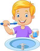 Cute little boy brushing teeth