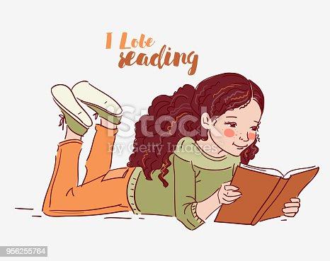 istock Cute little girl reading a book 956255764