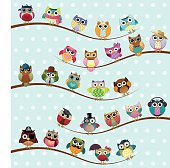 Cute Owls on a Branch with a Polk-a-dot Background