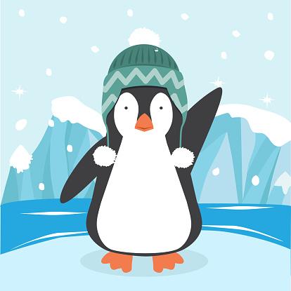 Cute penguin in a hat  on ice floe