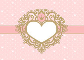 Cute pink background with polka dots and crown. Luxury gold photo frame in the shape of a heart.