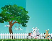 Cute rabbits the gang happy in the garden for Easter holiday,invitation,greeting card or poster,vector illustration