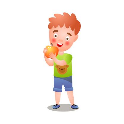 Cute red hair boy in green tshirt eating fresh apple