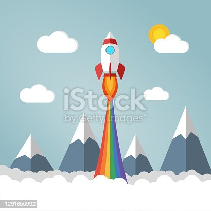istock Cute rocket launches in sky over mountains and clouds and emits rainbow colored smoke 1291855992