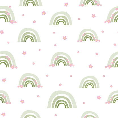 Cute seamless pattern of green rainbows with pink flowers. Boho print, texture from rainbows, wallpaper for nursery.