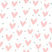 Cute seamless pattern with repeating hearts and round dots drawn by hand. Endless girlish print. Girly vector illustration.
