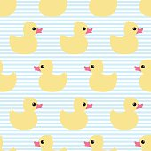 Cute seamless pattern with yellow rubber duck on striped background