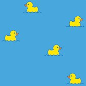 Cute seamless pattern with yellow rubber ducks on water