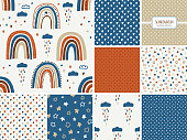 Cute scandinavian childish seamless pattern with trendy hand drawn rainbows, clouda and stars in naive art style, to use as kids texture for textile, wallpaper, apparel etc, vector illustration