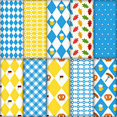 Cute set of seamless traditional Octoberfest patterns. Pretzels beer sausage lined up seamless vector illustration pattern. Blue and white checkered background. Perfect for Oktoberfest.