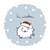 """Cute sheep in a cap of Santa Claus and the words: """"Hi, winter"""""""