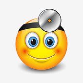 Cute smiling doctor emoticon wearing head-mirror, emoji, smiley
