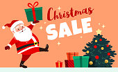 Cute smiling Santa Claus marching carrying a wrapped gift, Christmas Sale caption, decorated Christmas tree with presents in the background. Christmas sale design element for retail promotional poster