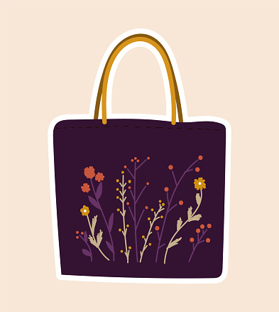 Cute sticker of purple bag sewed with flowers on cloth on pink background