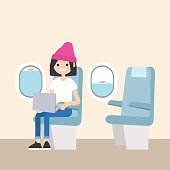 Cute teenage girl sitting in the plane