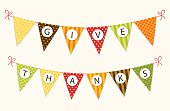 Cute Thanksgiving bunting flags with letters in traditional colors for your decoration