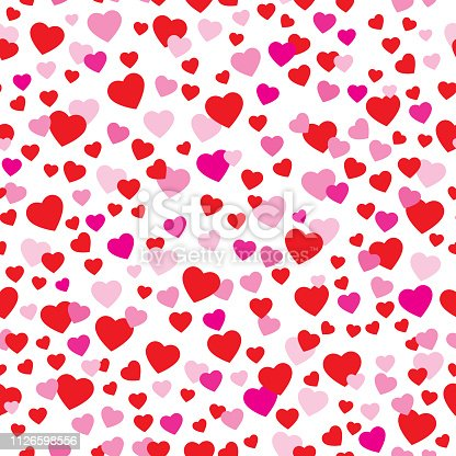 Vector seamless pattern of cute red and pink hearts on a white background.