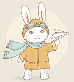 Cute vector pilot rabbit with paper airplane