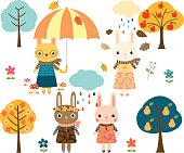 Cute vector set with autumn bunnies, umbrellas and trees